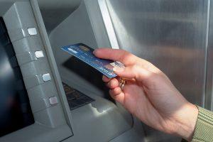 Hand using ATM